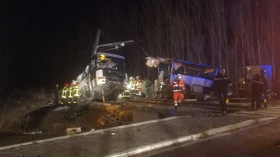 Rescue workers are seen on the site of collision between train and school bus in Millas, France December 14, 2017 in this handout picture.