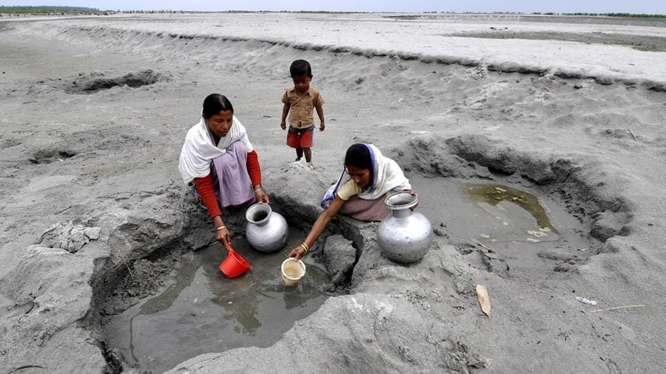 Villagers collect drinking water from the dried bed of Siang River at Berasapori village some 560 kms from Guwahati.