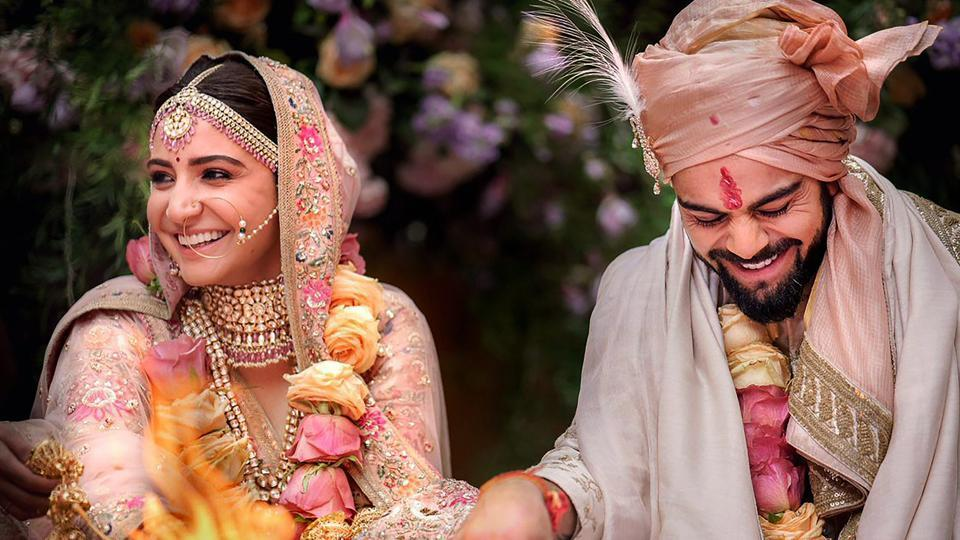 Indian cricket captain Virat Kohli with his actress wife Anushka Sharma during their wedding.