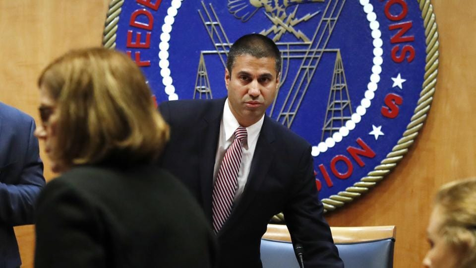 Federal Communications Commission (FCC) Chairman Ajit Pai, right, and Commissioner Mignon Clyburn, far left, are asked to leave by a member of security as the meeting room is evacuated where the Federal Communications Commission (FCC) was about to vote on net neutrality, Thursday, Dec. 14, 2017, in Washington.