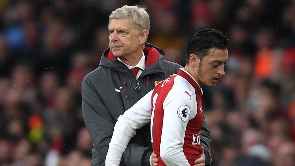 Arsenal Wenger (L) does not think Mesut Ozil would move from Arsenal to Manchester United.