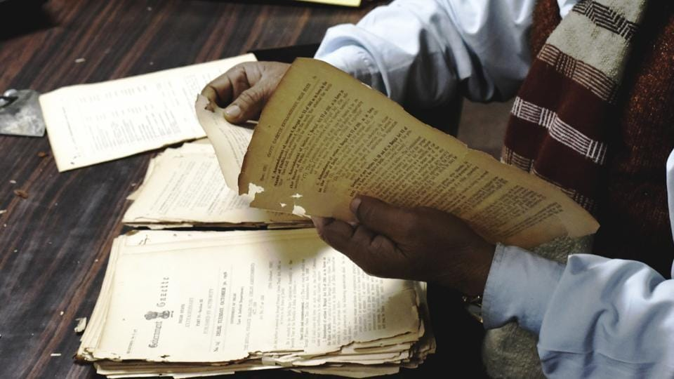 A copy of the Delhi Gazette being preserved by an archivist as part of the digitisation project. So far accessible to only researchers, this treasure trove will soon be a click away for those interested in the history of the national capital. (Vipin Kumar / HT Photo)