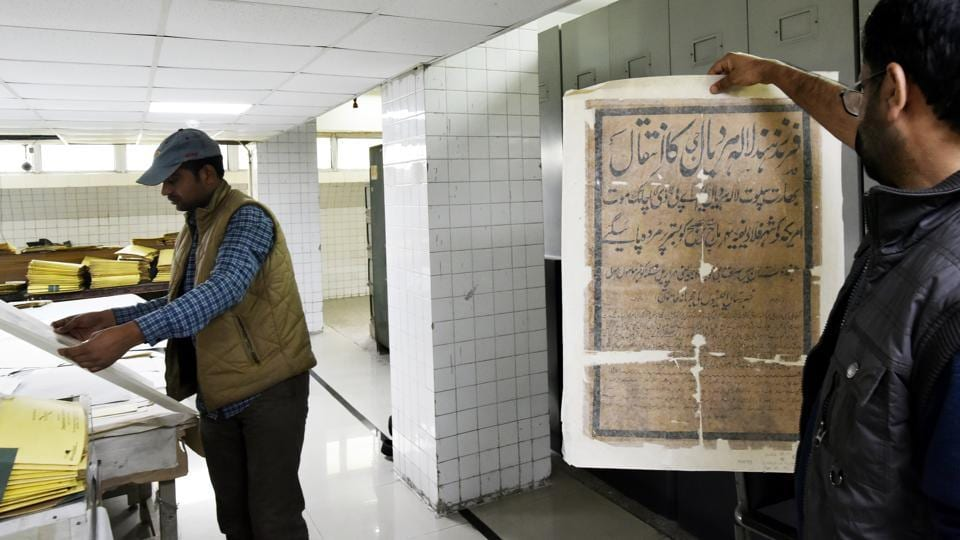 "A 100-member team of archivists, scholars and employees, led by Sanjay Garg, the chief archivist, are busy with the mammoth digitisation task using computers and high-end German-made scanners. ""We have got eight scanners for now. We digitise about 50,000 pages each day,"" he said. (Vipin Kumar / HT Photo)"