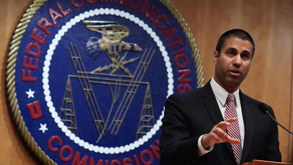Federal Communications Commission chairman Ajit Pai speaks to members of the media after a commission meeting on December 14, 2017 in Washington, DC. FCC has voted to repeal its net neutrality rules at the meeting.