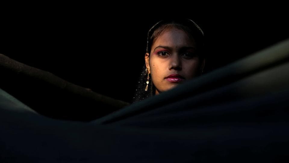 Mamataz Begum 18, a Rohingya refugee stands at the entrance of her temporary shelter at the Kutupalong refugee camp near Cox's Bazar, Bangladesh on  December 14, 2017. (Marko Djurica / REUTERS)