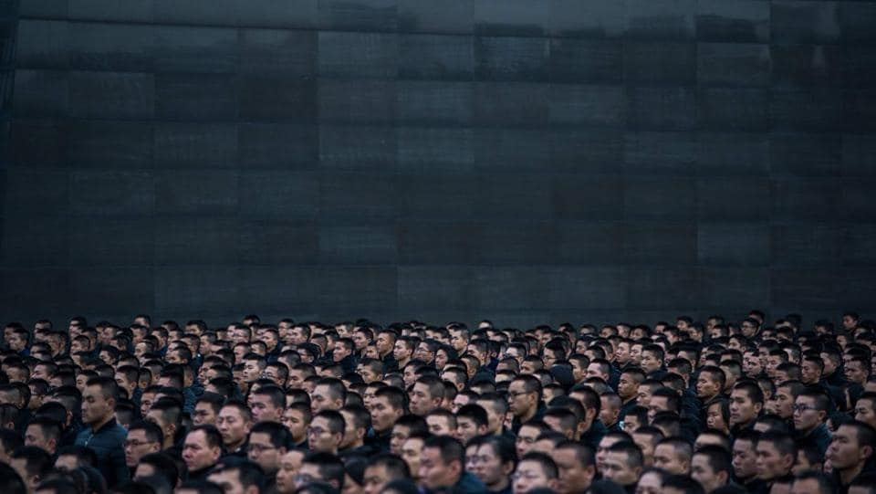 People participate in a ceremony at the Nanjing Massacre Memorial Hall on the second annual national day of remembrance to commemorate the 80th anniversary of the massacre in Nanjing on December 13, 2017. (Chandan Khanna / AFP)