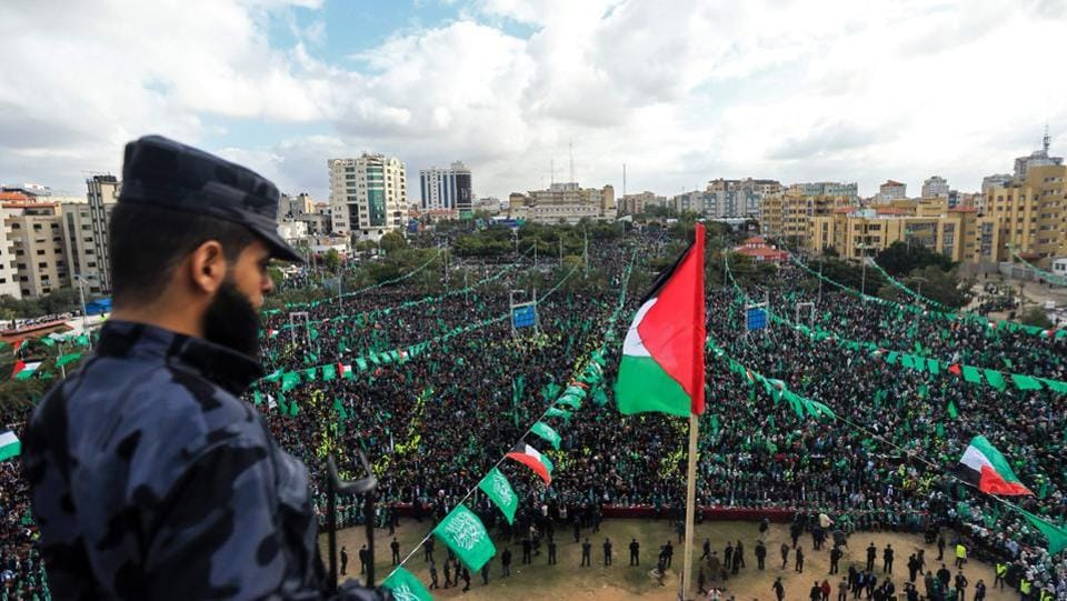 Hamas supporters take part in a rally marking the 30th anniversary of the founding of the Islamist movement, in Gaza City, on December 14, 2017. (Mohammed Abed / AFP)