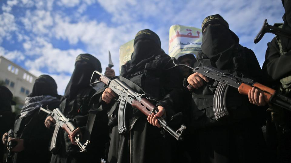 Armed female members of the militant Palestinian group Islamic Jihad carry Kalashnikov assault rifles as they take part in a rally to protest against US President Donald Trump's decision to recognise Jerusalem as the capital of Israel, in Gaza City on December 11, 2017. (Mohammed Abed / AFP)