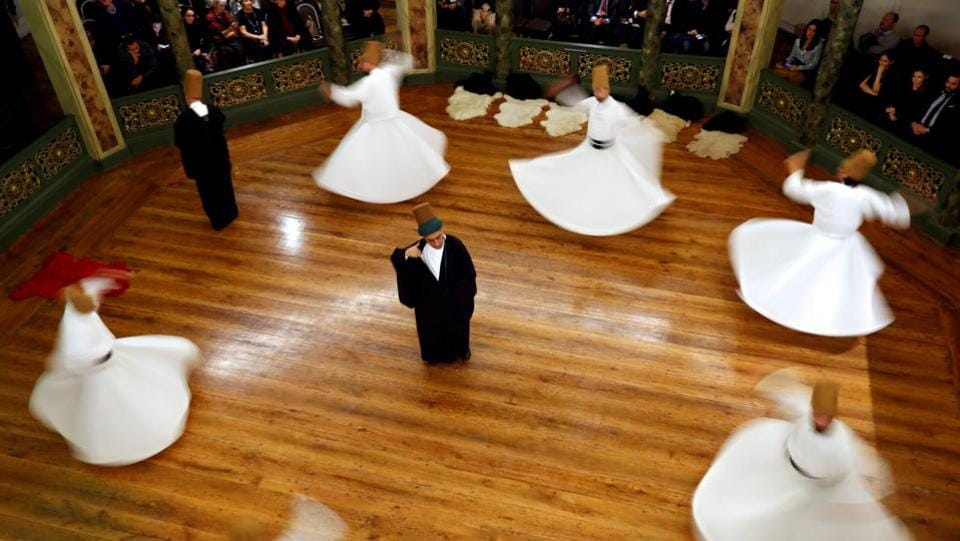 Whirling dervishes perform a