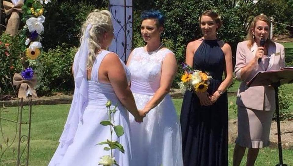 Fairfax Media said Lauren Price, 31, and Amy Laker, 29, solemnised their vows in Sydney, while Melbourne couple Amy and Elise McDonald -- who coincidentally have the same surname -- tied the knot two hours later.