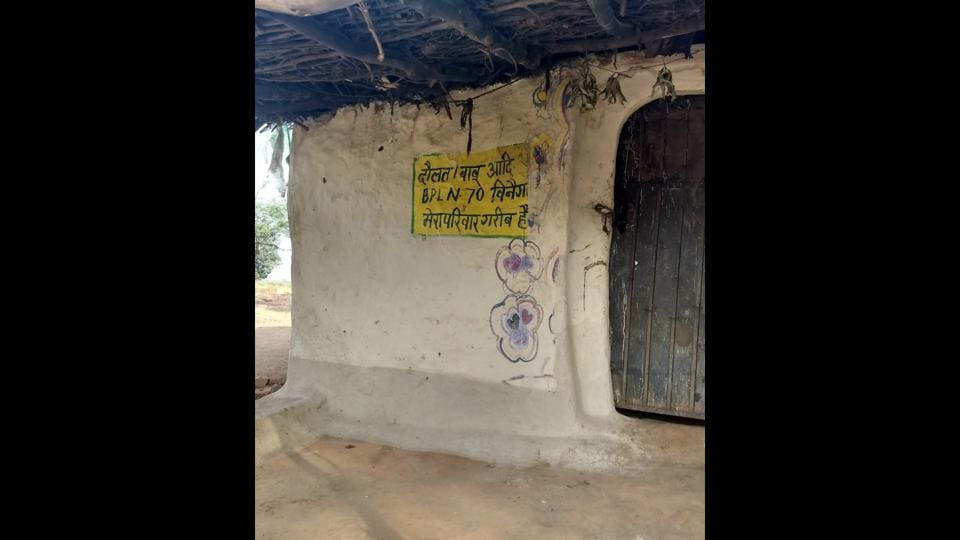 The words 'Mera parivar gareeb hai' (my family is poor) was painted on the walls of the houses of Shahria tribals in Binega village under Chandanpura panchayat.