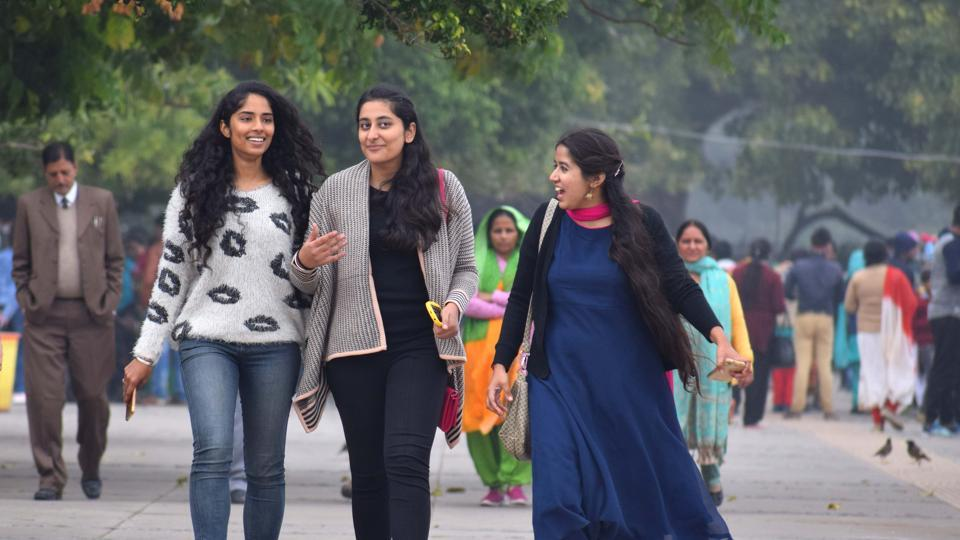 A group of girls taking a stroll at the lake on a cold afternoon in Chandigarh. (Sikander Singh/HT)