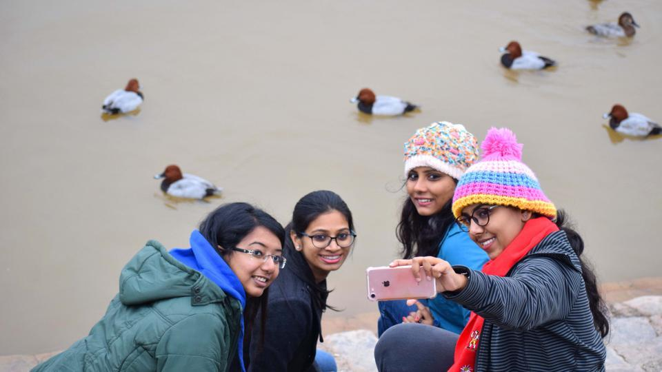 Girls take a selfie at Sukhna Lake on Thursday. (Sikander Singh/HT)