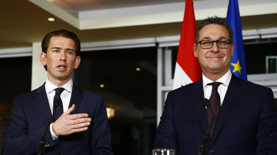 Head of the People's Party (OeVP) Sebastian Kurz (L) and head of the Freedom Party (FPOe) Heinz-Christian Strache address a news conference in Vienna, Austria, December 16, 2017.