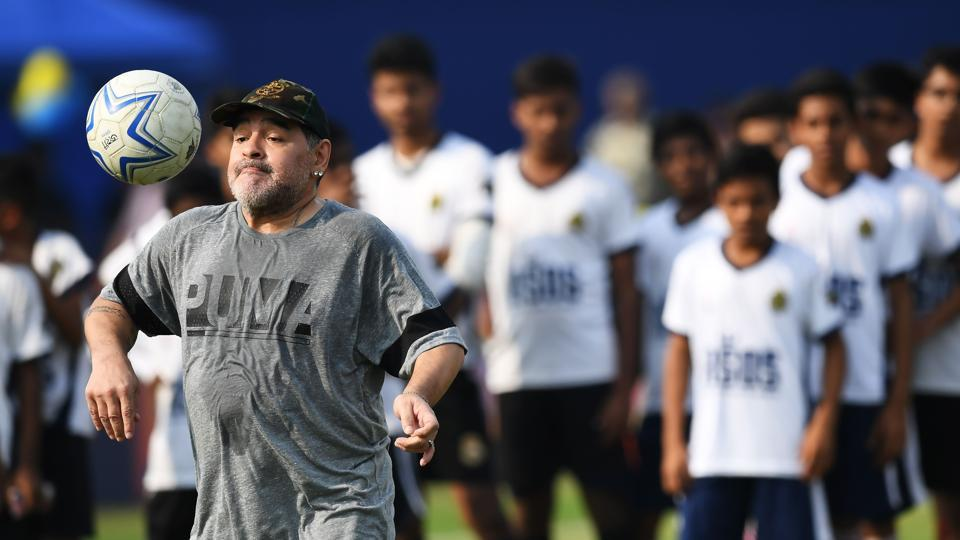 Argentinian football legend Diego Maradona shows his skills during a football workshop at Barasat in North 24 Parganas on Tuesday. (Ashok Bhaumik / PTI)