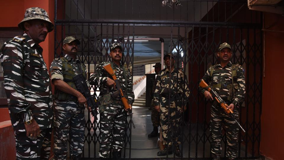 Paramilitary soldiers stand guard outside a gate leading to a room containing Electronic Voting Machines in Ahmedabad on December 15, 2017, a day after the second phase of the Gujarat legislative assembly election.