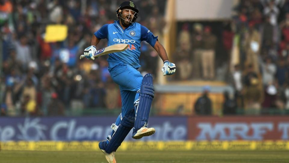 Indian captain Rohit Sharma celebrates his double-century during the second ODI cricket match against Sri Lanka in Mohali on Wednesday. Sharma became the first batsman in the world to hit three ODI double hundreds. (PTI)