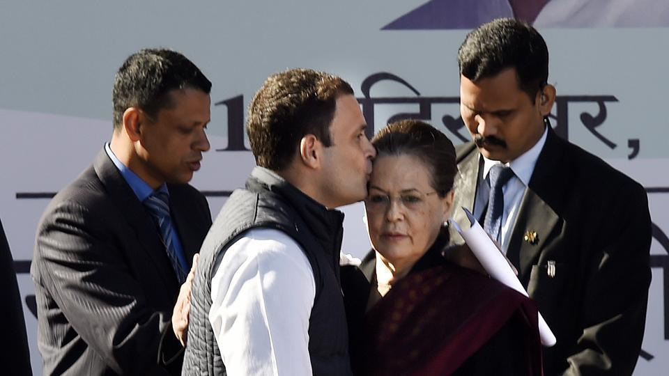 Newly elect Congress party president Rahul Gandhi (L) greets his mother and predecessor Sonia Gandhi after her speech during an elevation event held at the lawns of the All India Congress Committee (AICC) in New Delhi on Saturday. (Arvind Yadav / HT Photo)