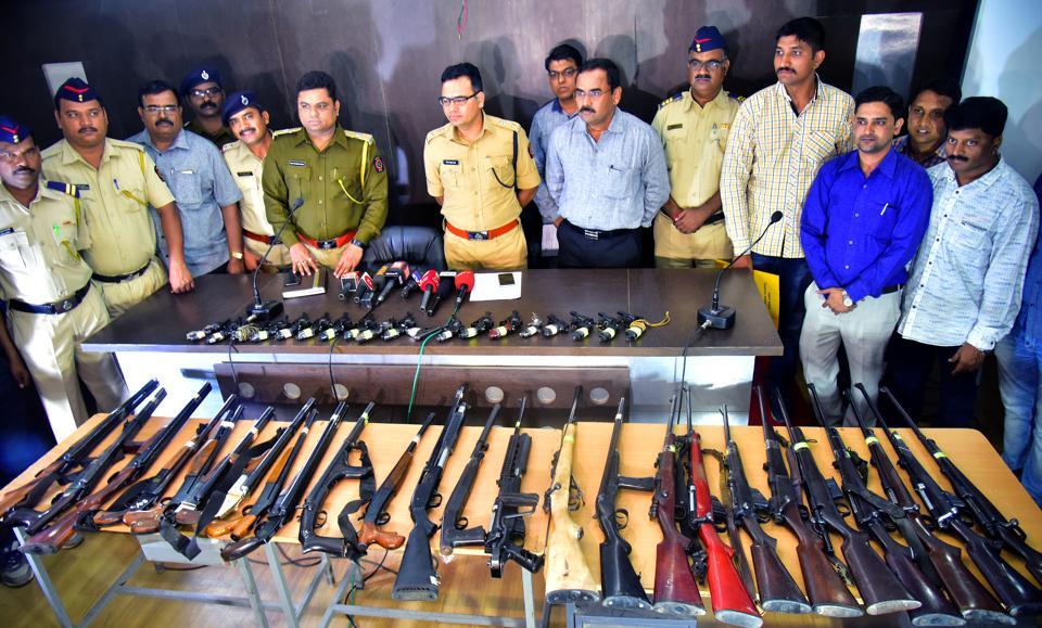 Nashik rural police with the seized arms near Chandwad toll naka on Agra-Mumbai highway.