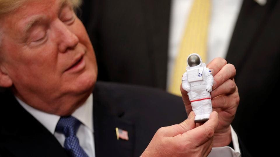US President Donald Trump holds a space astronaut toy as he participates in a signing ceremony for a new Space Policy Directive at the White House in Washington D.C. on December 11, 2017. (Carlos Barria / REUTERS)