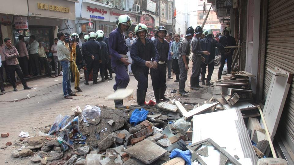Fire brigade officials at the site of the collapse.