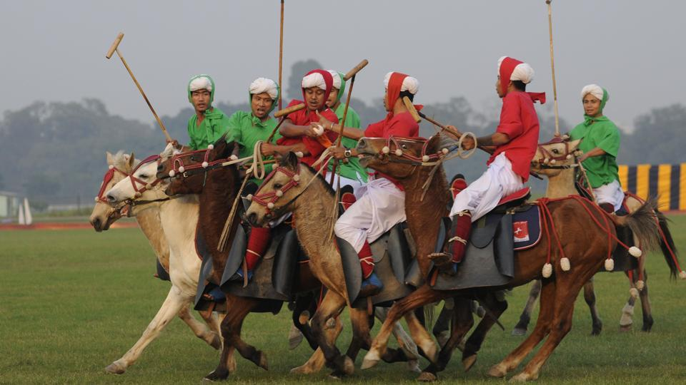 Manipuri players in traditional dress on their ponies known as Sagol Kangjei during Viijay Diwas to mark India's victory over Pakistan on 1971 at RCTC ground in Kolkata on Thursday. (Samir Jana / HT Photo)