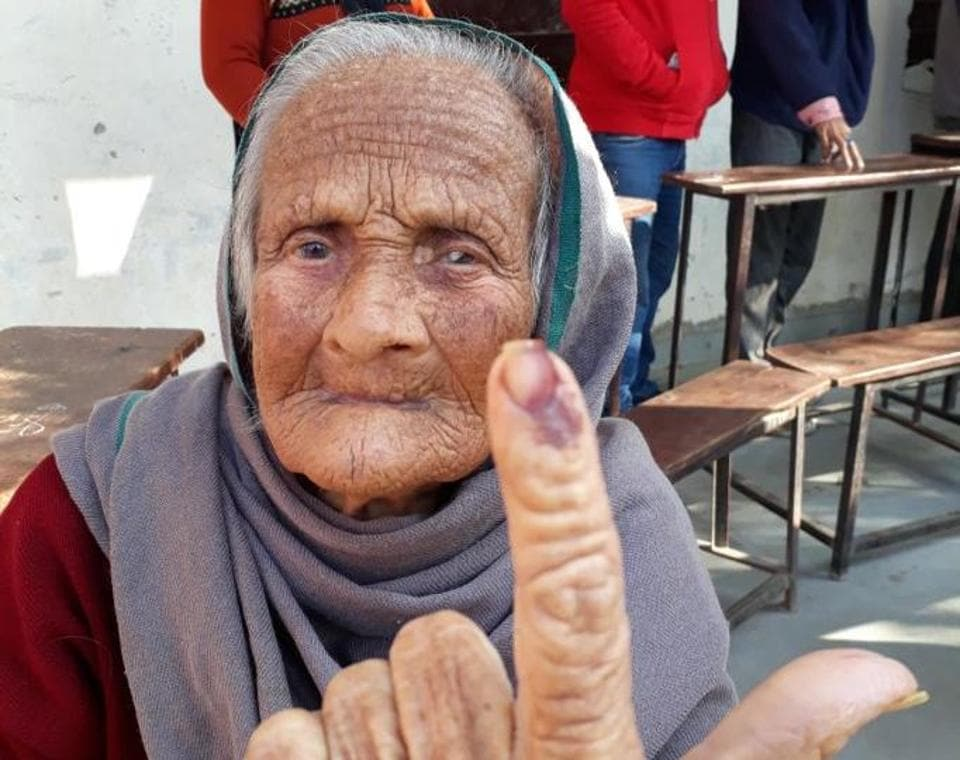 Ishri Devi , 105, posing for a photo after casting her vote in Jalandhar.  (Pardeep Pandit/HT)
