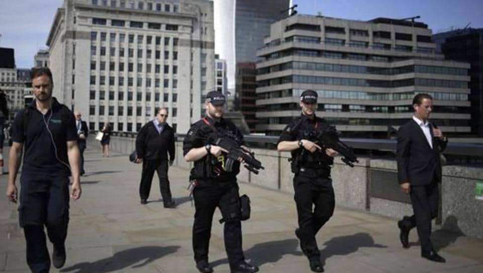 Armed police officers patrol on London Bridge in London, Wednesday, June 7, 2017.