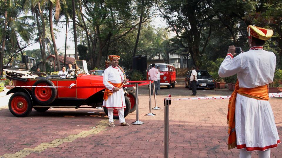 People dressed in traditional attire take photo with a vintage car. (Hemanshi Kamani /HT Photo)