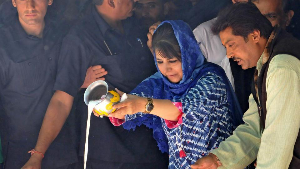 Jammu and Kashmir chief minister Mehbooba Mufti pours milk into a sacred pond during the annual Hindu festival at the Kheer Bhawani Temple at Tullamulla Ganderbal, some 28 Km northeast of Srinagar, in June 2017.