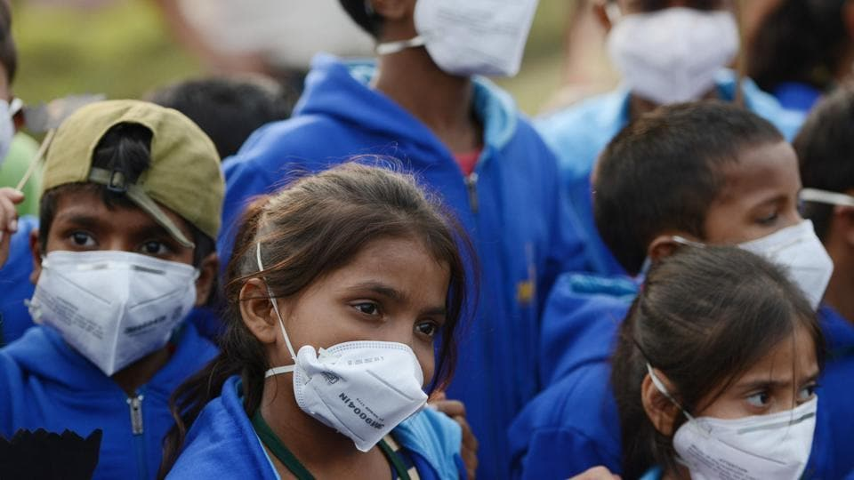 Children wearing air pollution masks attend a demonstration in New Delhi to spread awareness of the problem .