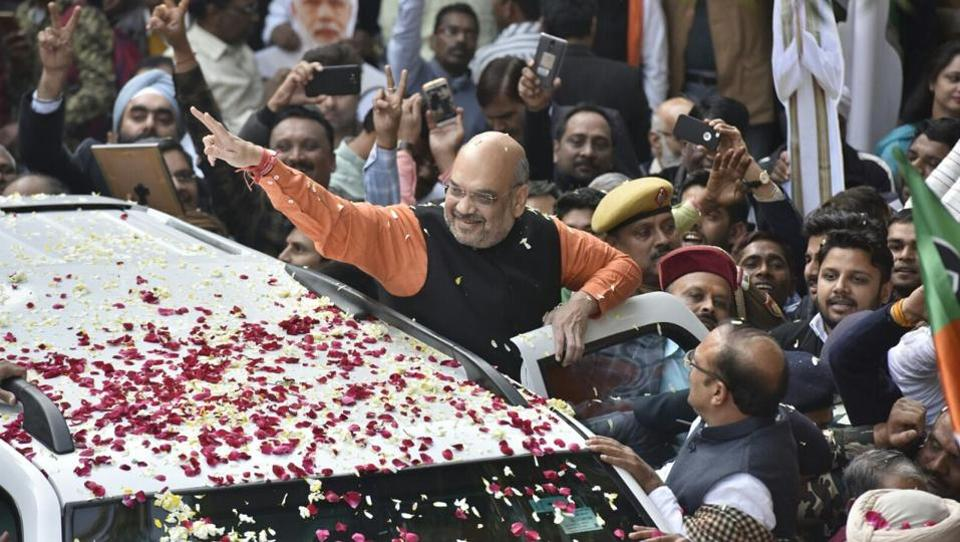 BJP national President Amit Shah greets supporters celebrating the BJP's assembly election results in Gujarat and Himachal Pradesh at BJP headquarters in New Delhi. As counting of votes for the 182-seat Gujarat assembly progresses after a two-phase election in PM Modi's home state, trends show the Bharatiya Janata Party set to win albeit with a reduced margin, with the Congress improving its tally this time over. (Sonu Mehta / HT Photo)