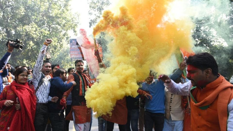 BJP workers celebrate party's win in Gujarat and Himachal Pradesh assembly elections at BJP headquarters in New Delhi. (Sonu Mehta /  HT Photo)
