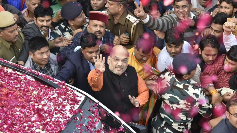 BJP president Amit Shah arrives at the party head quarters in New Delhi to address media. Amit Shah says the BJP's vote share in the state has increased by 10% from the last time. (Sonu Mehta /  HT Photo)