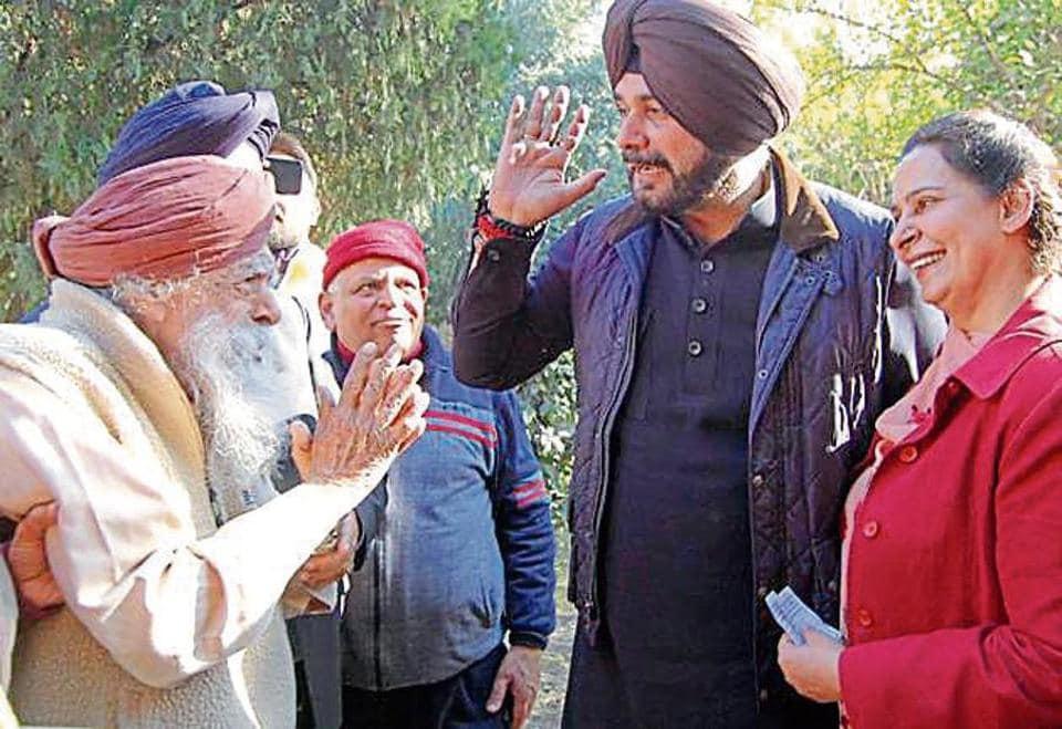 Minister Navjot Singh Sidhu and his wife, former MLA Navjot Kaur Sidhu, meet voters in Amritsar on Sunday