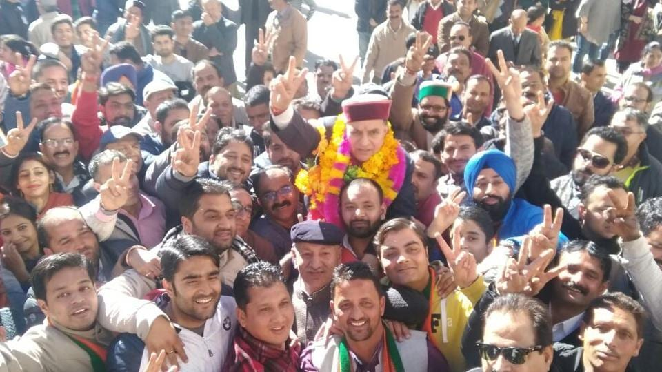 BJP candidate from Shimla, Suresh Bhardwaj, celebrates his victory with supporters in Himachal Pradesh. Counting of votes began at 8am in the hill state that witnessed a record 75.28% turnout. Election Commission officially declared the first seat in Himachal Pradesh elections 2017 for Congress candidate Anirudh Singh from the Kasumpti constituency. Singh defeated Vijay Jyoti by a margin of 9,397 votes. (Deepak Sansta / HT Photo)