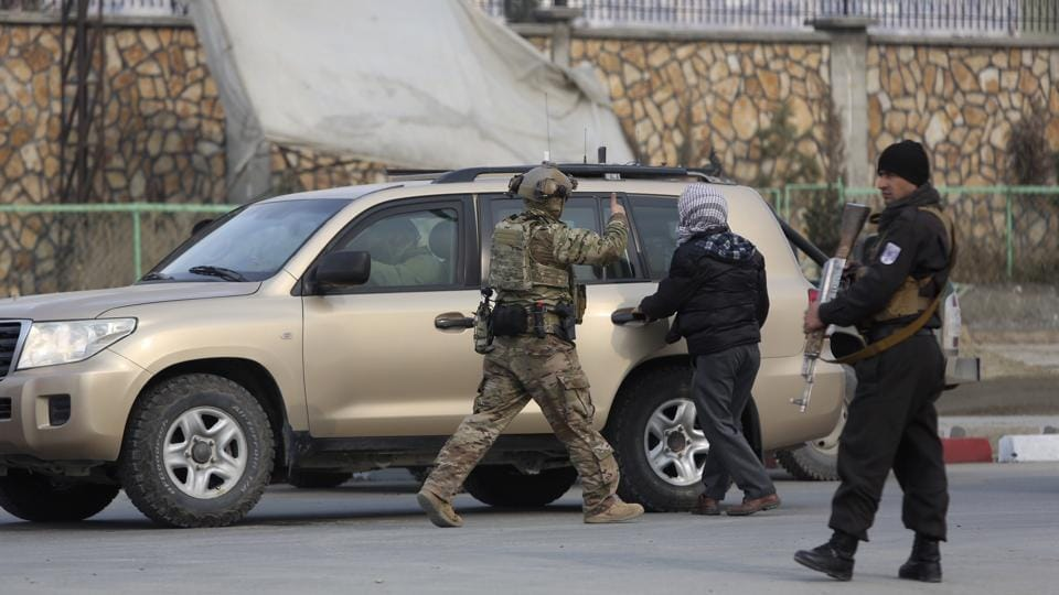 Afghan security personnel and US forces arrive at the site of an attack near an intelligence training centre in Kabul, Afghanistan, on December 18, 2017. An Afghan official said the attack is underway in the capital where gunmen have raided and occupied a partially constructed building near the intelligence training centre.