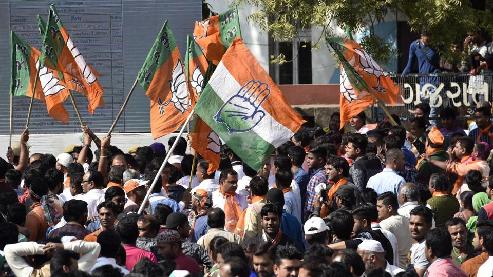 Congress and BJP supporters gather near counting centre at Ahmedabad on December 18.