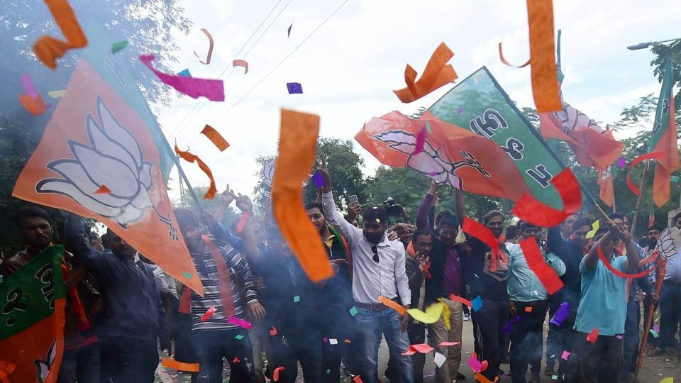BJP workers burst fire-crackers to celebrate their victory in the Assembly elections, at the party office 'Kamlam' in Gandhinagar on Monday.