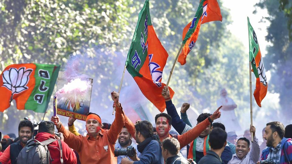 BJP workers celebrate party success in Gujarat and Himachal Pradesh state assembly elections outside the BJP headquarters, in New Delhi, on Monday.