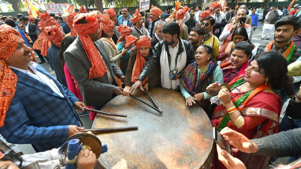 Party workers and supporters celebrating the BJP's success in Gujarat and Himachal Pradesh outside the BJP headquarters, in New Delhi on Monday