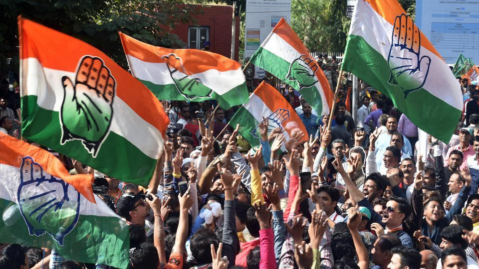 Congress supporters celebrate after a party candidate's win in the assembly elections, outside the Gujarat College counting centre in Ahmedabad.