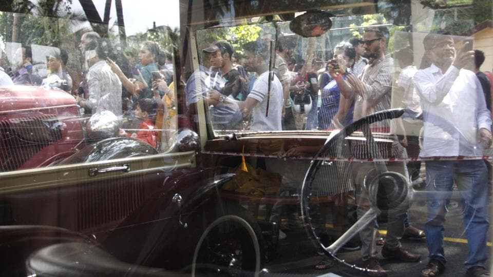 People photograph one of the vintage cars on display. (Hemanshi Kamani /HT Photo)