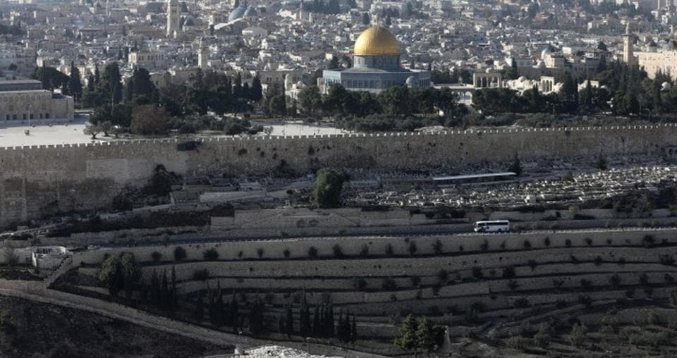 A general view of Jerusalem shows a Jewish cemetery on the Mount of Olives in the foreground and the Dome of the Rock, located in Jerusalem's Old City on the compound known to Muslims as Noble Sanctuary and to Jews as Temple Mount, in the background December 10, 2017.