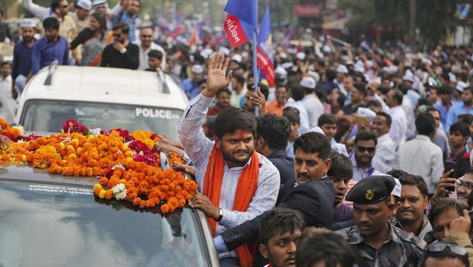 Patidar leader Hardik Patel waves to people during his roadshow in Ahmadabad,