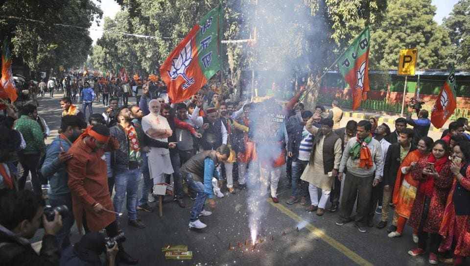 BJP supporters burn firecrackers to celebrate the party's win in Gujarat and Himachal Pradesh state assembly elections in New Delhi, on Monday.