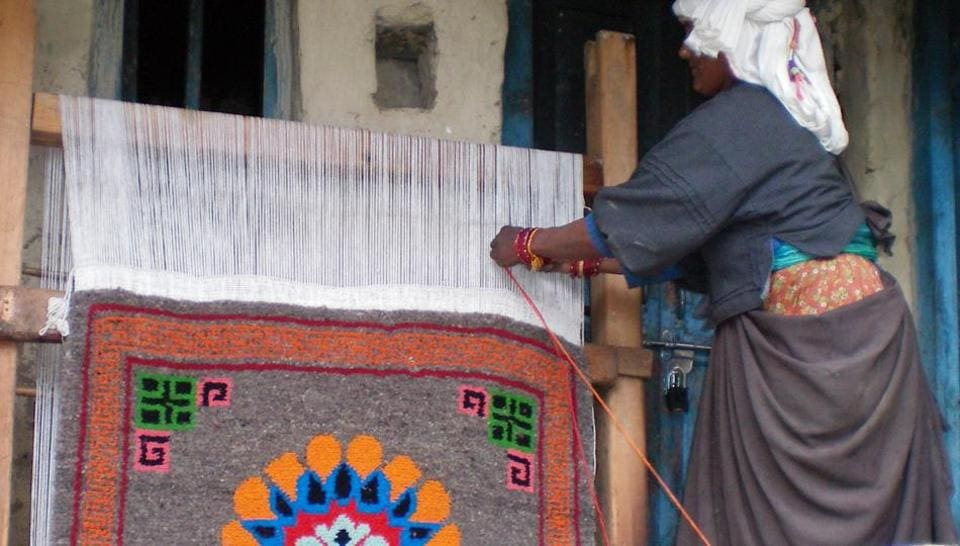 A tribal woman weaves carpet in Mana, the last Indian village close to Indo China border in Uttarakhand.