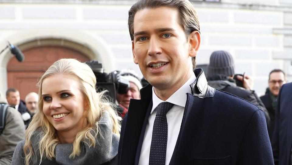 Head of the People's Party (OeVP) Sebastian Kurz and his girlfriend Susanne Thier leave the presidential office after he was sworn in as Austrian Chancellor in Vienna, Austria, December 18, 2017.
