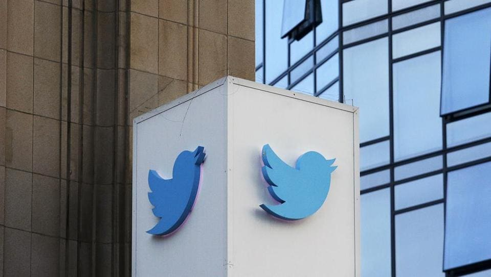 A Twitter sign outside the company's headquarters in San Francisco. Twitter will be enforcing stricter policies on violent and abusive content.
