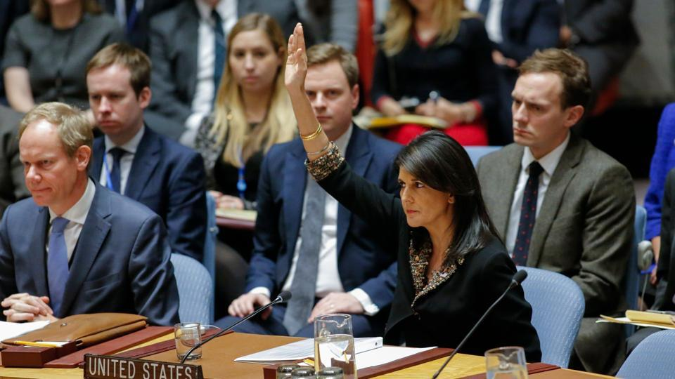 US Ambassador to the UN Nikki Haley raises her hand as opposed to the vote on a draft resolution that would reject US President Donald Trump's decision to recognize Jerusalem as the capital of Israel during a meeting on the situation in the Middle East including Palestine on December 18, 2017, at UN Headquarters in New York.